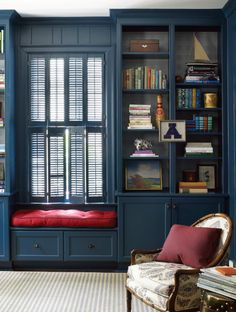 Window seat nestled between shelves in an amazing admiral blue | Lindsey Coral Harper