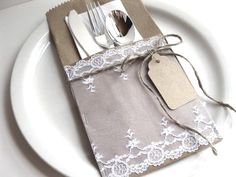 Pretty Paper Pockets white vintage lace silverware by BluePearls...but no lace.