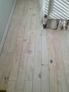 "DIY Plank Floors: cut plywood into 4"" wide strips, glue and nail down, whitewash with diluted Annie Sloan white chalk paint, seal with Stay Clear acrylic polyurethane."