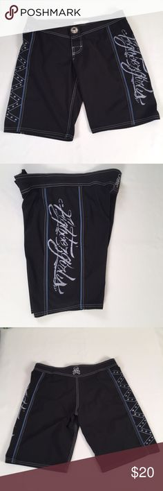 MMA alpha female Board shorts MMA Alpha female fight wear ladies shorts 30 inch waist.  Color is black and blue.  Velcro closure and drawstring waist.  100% polyester.  Excellent condition Clean and ready to wear. No stains, snags or damage Originally $60.00  Comes from a pet free smoke free environment. Looking for more shorts check out my closet.  Thanks M97/W60 Alpha female Other