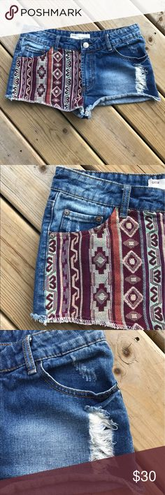 Denim Aztec/Ethnic Boho Shorts Size 8 How cute are these?! Distressed denim shorts with Aztec print on one leg and on the back of one pocket. UK size 14 which is equivalent to a US 8. Worn 1-2 times, excellent condition! No trades, thank you. boutique Shorts