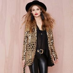 Nastygal sequin blazer. Party time, excellent. The Party Isn't Over Blazer is a gold sequin boyfriend blazer featuring animal print sequins and a long, oversized fit. Fully lined, front pockets. Structured, lightly padded shoulders. Pair it with skinnies and a leather bustier. By Nasty Gal.  *Cotton/Polyester Blend  *Model is wearing smallest size available  *Runs true to size  *Hand wash cold  *Imported Nasty Gal Jackets & Coats Blazers