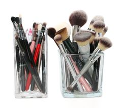 makeup brushes stored in vases