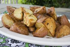 Oven roasted potatoes are a simple and healthy side dish to make and require only a few simple ingredients: garlic, rosemary, olive oil, salt, and pepper.