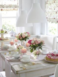 Beautiful breakfast nook table setting with fresh roses.