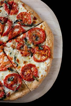 "Think pizza is a ""No No"" when you're trying to lose body fat? Well it isn't when you use healthy ingredients like whole grain pizza dough like this pizza recipe suggests."