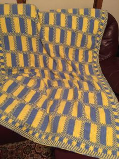 """The blanket is approx 45"""" x 65"""" made in a yellow and baby blue stripe theme. May also remind you of the Ukrainian flag."""
