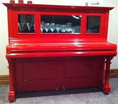Upcycled piano created for my wife's birthday. Stripped out and turned into China cabinet. Lit with LED in top cabinet.