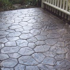 Putting in a patio? Consider stamped concrete for a unique, durable look!