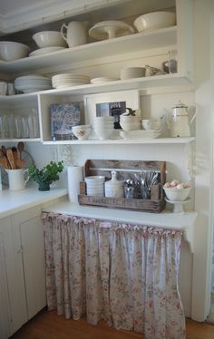 Sunday Comfort - Favorite Things in the Kitchen - Open Shelving - displaying collected ironstone on white painted shelves, with a gathered curtain used to hide the necessities that aren't so pretty - Tresor Trouve