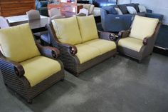 Three piece yellowish patio set, two chairs and one loveseat