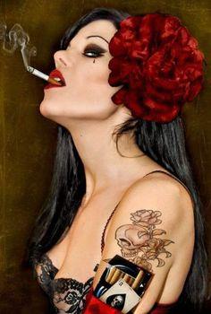 ♫ Dizem que Pombagira é uma rosa / É uma rosa que nasceu no meio do espinho / Maria Padilha, rosa sem espinho / segue os meus passos / ilumina os meus caminhos ♫