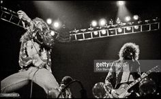 Robert Plant and Jimmy Page from rock group Led Zeppelin perform live on stage at Earls Court in London on 24th May 1975.