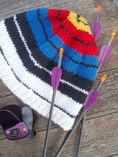 This is my pattern for a beanie which looks like an archery target. The ribbed band should fold up and still allow the the first black line to show. If you want to make the ribbing deeper, keep in …
