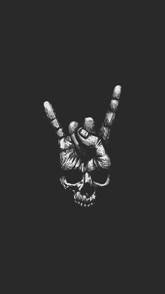 A scull shaped with fingers making the most used symbol during a metal-concert; the devil horns...:)cool