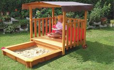 Sandbox with roll over covered deck.