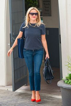 Polka dot top, jeans, bright red flats. Cute business casual look.