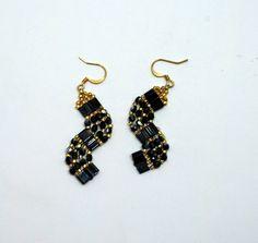 Tila Bead Black and Gold Curved Beaded Earrings by JKAlvarez.  Item 3030BG. $20.00, via Etsy.