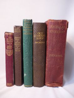 Five old Dickens books.