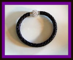 Faux Leather Bracelet with magnetic rhinestone clasp. Fits wrists up to 8 inches.  Great colors.