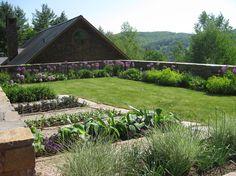 Traditional Landscape by Saucier + Flynn, Ltd.