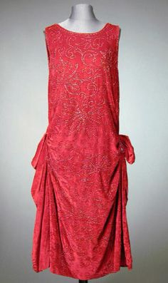 Raspberry Velvet Chemise Dress  1920s   Sleeveless, with low waist accented with side drapery, the surface ornamented with overall floral pattern embroidery worked in iridescent pink beads, back half rope belt