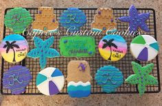 Custom beach cookies! Beach balls, seashells, sand castles, and starfish. Sunset palm tree cookies are all hand painted. Decorated with royal icing.