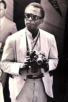Miles Davis with his Leica m3 fitted with a Selenium meter. Image credit: Celebrity Camera Club