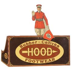 """Footwear Display. 13.5 x 14 x 5 early die-cut tin litho countertop advertising display for Hood Rubber Co. footwear products. Clean, bright and very impressive graphic of a Mountie tops the display. Display reads """"Hood Rubber-Canvas Footwear"""""""