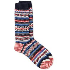 Replenish your sock drawer with the woven patterns of CHUP socks. Made in Japan from a soft stretch cotton blend, each pair is woven with a colourful array of patterns. Emulating the ancient Nordic county, the design of the Snjor sock looks to the snow dancing sky with sky patterns of scattered polka dots.  Cotton-Blend Yarn Made In Japan