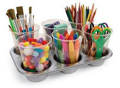A muffin pan becomes a craft caddy. Magnets hold the plastic cups down to make them tip-resistant.