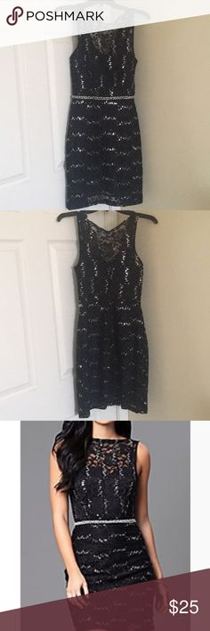 Black mini dress with sequins. Black lace mini dress with sequins. And V back. It's a size 3 but it fits a small. Worn once to an event. City Triangles Dresses Mini