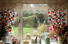 Patchwork curtains over the Kitchen. i love the idea and it is looking lovely with the lace contrast.