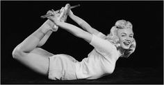 Marilyn Monroe practices Dhanurasana.