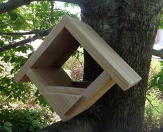 """Diamond shaped bird feeder. A cedar bird feeder 8 1/2"""" tall x 11"""" wide x 5 1/2 thick"""". lightly sanded to balance outside functionality with beauty. Each will have its own unique character as they are handmade. If you would like to order more than one item, please message us so that we can ship the items together and save you on shipping prices."""