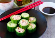 These paleo friendly sushi are made with cucumber shells, lightly cooked salmon and fresh avocado. Perfect for paleo dinner, lunch or as finger food at a party.