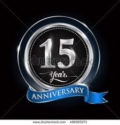 Celebrating 15 years anniversary logo. with silver ring and blue ribbon.