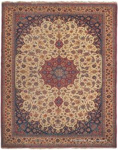 Isfahan, 10ft 9in x 13ft 8in, Circa 1925.  Fluid tracery and painstaking attention to detail lend great distinction to this formal court carpet of the well-loved Isfahan style. Jewel-like hues of ruby and sapphire draw the eye to its elegant central medallion, as a swirling profusion of nuanced vinery fills the surrounding reserve. Soft sand and sky blue bring additional refinement to its brilliantly harmonious naturally dyed palette, imparting a subdued majesty to the composition.