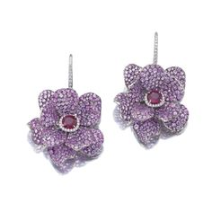 Pair of ruby, sapphire and diamond earrings, Michele della Valle Each designed as a flower, the petals pavé-set with circular-cut pink sapphires, the centre set with a cushion-shaped ruby within a border of brilliant-cut diamonds, post fittings, signed MdV, pouch stamped Michele della Valle.