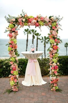 Pink and Green Ceremony Arch | Sherri J Photography | Theknot.com