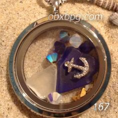 Cobalt glass, Swarovski crystals and a floating anchor charm make up this brand new design (#167) Seaside Memory Locket. http://bluepelicangallery.com/product/seaside-memory-lockets
