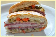 Muffuletta Recipe: The Muffuletta is a signature  sandwich of New Orleans and while it is time-consuming, it is worth the effort. It is great for holidays, parties, or any day of the week.