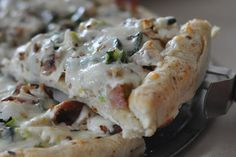 Chicken Bacon Pizza....make with ranch dressing mushrooms, tomatoes, and jalapeños or spinach