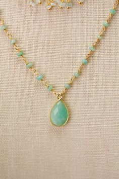 A light and airy blend of apatite and pearl is blended with gold filled in a triple multi strand. A unique addition to your designer jewelry collection. Gold filled Apatite, freshwater pearl Approx