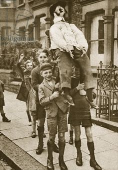 Children carrying a 'Guy Fawkes' on Bonfire Night (sepia photo) by English Photographer / The Stapleton Collection Bonfire Night Guy Fawkes, Guy Fawkes Night, Penny For The Guy, British History, London History, Uk History, The Twenties, Vintage Photos, Vintage Photographs
