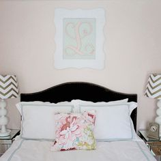 Loved the framed initial above the bed & the chevron lamp shades