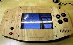 """This oversized wooden Game Boy Advance created by Ryan Bates of RetroBuiltGames. Its screen is bigger than the original Game Boy Advance. Bates has named his creation the """"GBA XXL."""" Its brain is a Raspberry Pi B+. Game Boy, Computer Projects, Electronics Projects, Arcade Controller, Diy Arcade Cabinet, Diy Tech, Raspberry Pi Projects, Arcade Machine, Building Toys"""