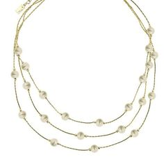 A contemporary twist on the classic faux pearl strand necklace! Glittering golden faux pearls drip