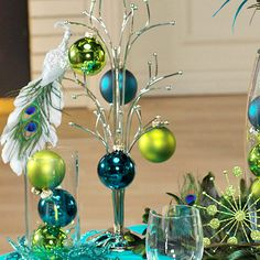 Use these Christmas table decorations as inspiration for all your parties this holiday season. Each Christmas table is packed with easy, inexpensive decorating ideas for Christmas centerpieces and holiday place settings. Peacock Christmas Tree, Blue Christmas, Christmas Colors, All Things Christmas, Christmas Themes, Christmas Holidays, Christmas Crafts, Christmas Kitchen, Christmas Ornaments