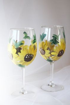 Hey, I found this really awesome Etsy listing at https://www.etsy.com/listing/160175882/sunflower-wine-glasses-hand-painted-wine